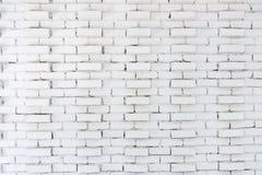 Abstrakt vit bakgrund f?r tegelstenv?gg i lantligt rum, grungy rostiga kvarter av stenhuggeriarbetearkitekturtapeten arkivfoton