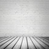 Abstrakt vit inre med trägolvet Arkivbilder