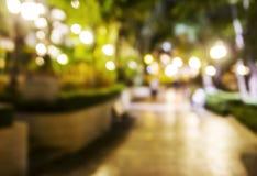 Abstrakt zamazywał tło jawny park przy nocą Zdjęcie Stock