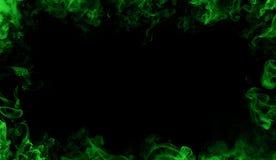 Abstrakt zieleni płomieni rama na odizolowywał czarnego tło zdjęcia royalty free