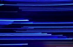 Abstrakta blåa lysande linjer bakgrund Fotografering för Bildbyråer