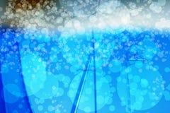 Abstrakta bokehblått Royaltyfria Bilder