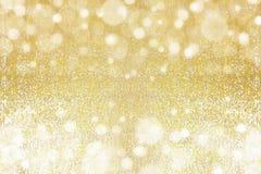 Abstrakta bokehljus för guld Royaltyfria Foton