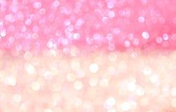 Abstrakta bokehljus för vit och för rosa färger. royaltyfri bild