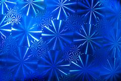 Abstrakta deseniowy tło z round segmentami z promieniami na błękitnym holograficznym papierze zdjęcia stock