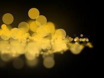 Abstrakta gula bokehcirklar Arkivfoto