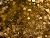Abstrakta guld- Bokeh cirklar bakgrund Guld- suddig bakgrund, Arkivbilder