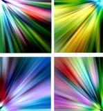 Abstrakta mångfärgade bakgrunder - strålar Arkivfoto