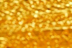 Abstrakta modeller för färgrik guld- bokehtextur för bakgrund fotografering för bildbyråer