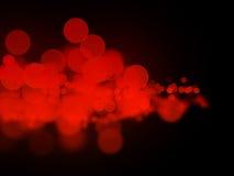 Abstrakta röda bokehcirklar Arkivfoto