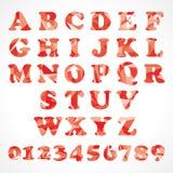 Abstrakta röda triangelalfabet Arkivfoto