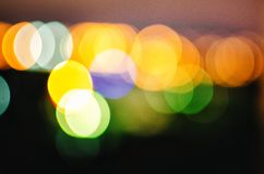 Abstrakta rozrzucony tło z bokeh Rozjarzeni żółci punkty na ciemnym tle zdjęcie royalty free