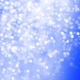 Abstrakta srebra światło na błękitnym zamazanym tle Zdjęcia Stock