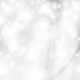 Abstrakta vita skinande ljus, silverbakgrund Arkivbilder