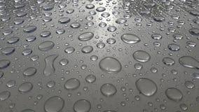 Abstrakte Beschaffenheit des Wassertropfens auf dem Tisch nach Regen stockfotos