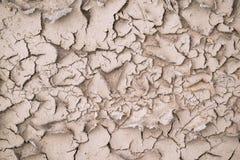 Abstrakte braune Beschaffenheit des runzligen sandigen Bodens Stockfotografie