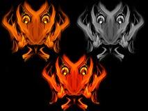 Abstrakte brennende Teufelgesichter Stockfotos