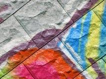 Abstrakte Farben-Graffiti, gemalter Steinhintergrund, Stockbild