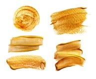 Abstrakte goldene Abstriche auf weißem Hintergrund mit Platz für Text Lizenzfreie Stockfotografie