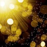 Abstrakte goldene Leuchte Stockbild