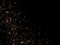Abstrakte Goldfunkeln-Explosion Stockfoto