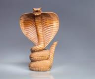 Abstrakte hölzerne Kobra Stockbild