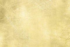 Goldhintergrundbeschaffenheit - Schmutzentwurf Lizenzfreie Stockfotografie