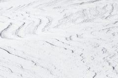 Abstrakte Hintergrundbeschaffenheit der glänzenden Schneewehe Stockfotografie