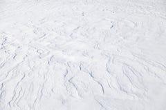 Abstrakte Hintergrundbeschaffenheit der Schneewehe Stockbilder