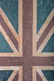 Abstrakte Hintergrundwand mit britischer Flagge Stockbild