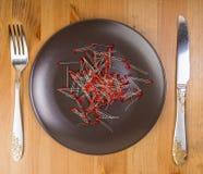 Abstrakte Idee der Technologie als Lebensmittel, irgendeine LED auf der Platte Stockbild