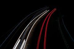 Abstrakte Leuchten im Rot, im Blau und im Weiß Stockfotografie
