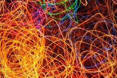Abstrakte mehrfarbige glühende Formen als Hintergrund Lizenzfreies Stockbild