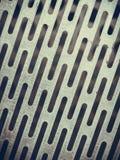 Abstrakte Nahaufnahme der Stahlbeschaffenheit mit Löchern Lizenzfreies Stockbild