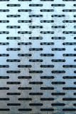 Abstrakte Nahaufnahme der Stahlbeschaffenheit mit Löchern Stockfotos