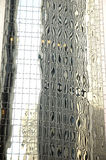 Abstrakte Reflexionen des Glasbürohauses Stockbilder