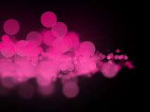Abstrakte rosa bokeh Kreise auf dunklem Hintergrund Lizenzfreie Stockbilder