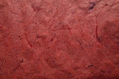 Abstrakte rote Beschaffenheit und Hintergrund für Designer Schönes Foto Raue rote Beschaffenheit des Recyclingpapiers Stockfotografie
