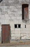 Abstrakte Studie der Steinmetzarbeit und der Holztüren Stockfotografie