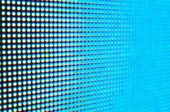 Abstrakte Unschärfe de-fokussierter blauer geführter Schirm Lizenzfreie Stockbilder