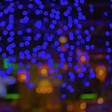 Abstrakte Unschärfestadteile oder Lichthintergrund bokeh Gelb des blauen Grüns des Nachtclubs purpurroter Stockbild