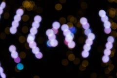 Abstrakte violette, braune bokeh Lichter Stockfotografie