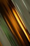 Abstrakte winklige Streifen des Grüns und des Goldes Stockfotografie