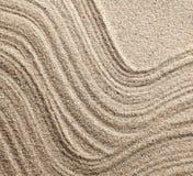 Abstrakte Zeilen auf Sand Stockbilder