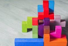 Abstrakter Bau von Holzklötze tetris Formen Lizenzfreies Stockfoto