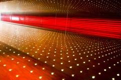Abstrakter Beleuchtungsholzgehweg Stockbild