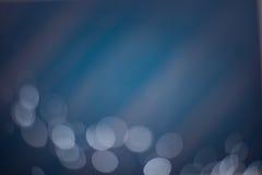 Abstrakter blauer bokeh Hintergrund Stockfoto