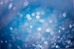 Abstrakter blauer bokeh Hintergrund Lizenzfreies Stockfoto