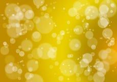 Abstrakter bokeh Hintergrund im Gold Lizenzfreie Stockfotografie