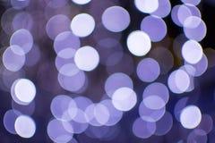 Abstrakter bokeh Hintergrund von Weihnachtslichtern nachts Stockbilder